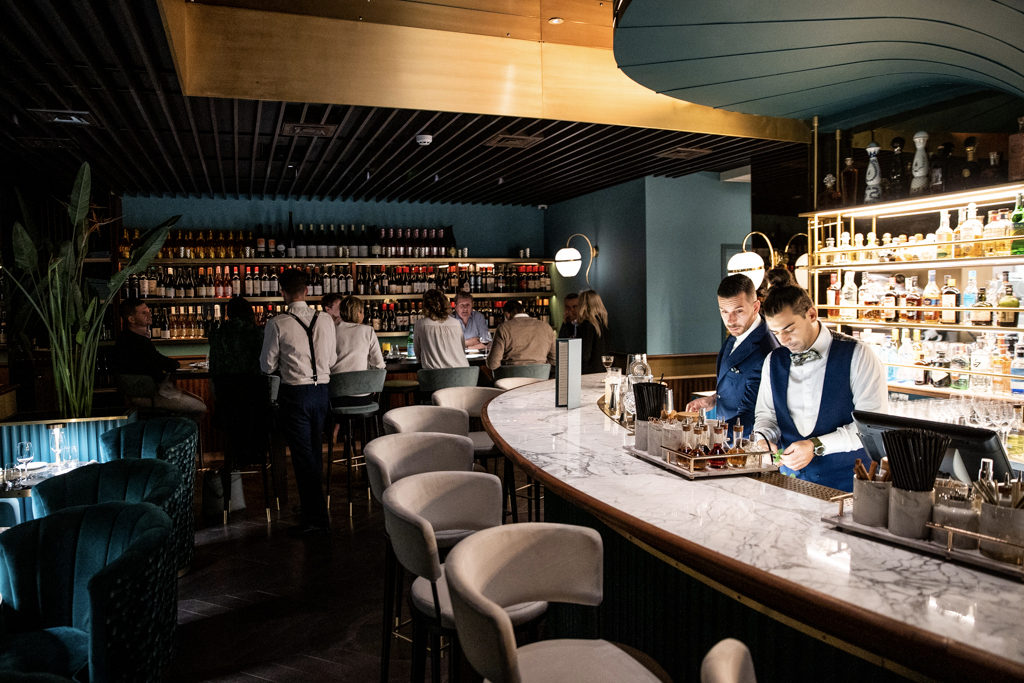 Tables are shared, kitchens become a stage for performing chefs, and especially after lockdown, spaces are opening up, inviting customers into the mix, so they don't feel alone anymore.